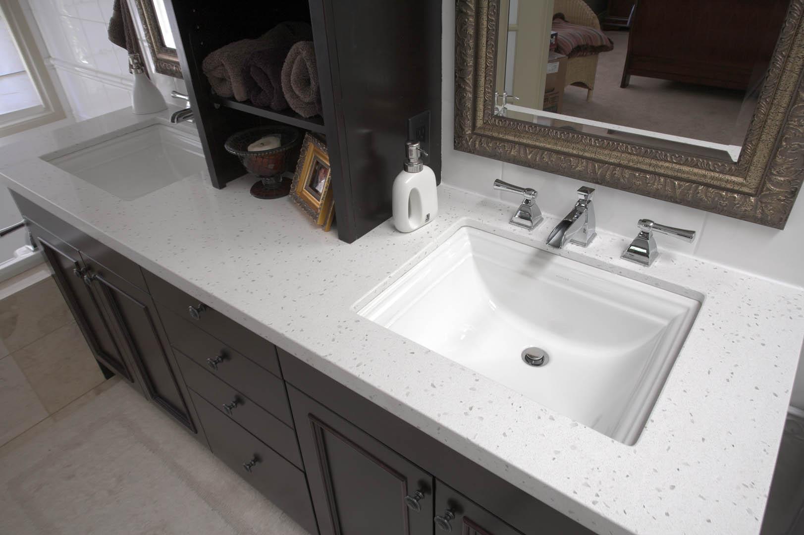 Silkstone granite calgary custom granite countertops for Granite bathroom